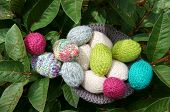 image of gift basket  - Handmade basket of egg Easter symbol traditional culture closeup of egg on green background knit gift from wool to make decorative on holiday - JPG