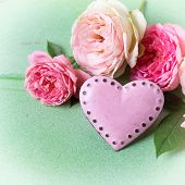 pic of blush  - Blush roses and decorative heart in ray of light on green wooden background - JPG