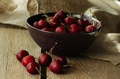 pic of black-cherry  - Bowl with black cherry rustic selective focus horizontal - JPG