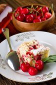 pic of fruit bowl  - Vertical photo of three cherries in front of fruit pie on the plate together with spoon - JPG