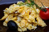 foto of scrambled eggs  - Scrambled eggs with tomato dill and black olive - JPG
