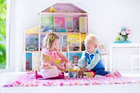 stock photo of baby doll  - Kids playing with doll house and stuffed animal toys - JPG