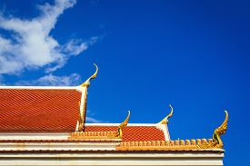 picture of gable-roof  - Roof gable in Thai temple with clear blue sky - JPG