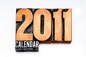 2011 Calendar done in vintage, gritty and colorful letterpress type. Shallow focus and slight cross-