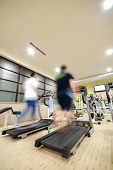 Man running on treadmill in gym