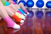 fitness exercise with girls and colorful socks in focus