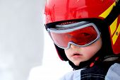 little boy portrait with helmet at winter holyday