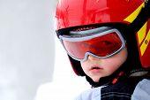 little boy portrait with helmet at winter holyday