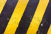 Постер, плакат: Grunge Black And Yellow Stripes Surface As Warning Or Danger Pattern Old Concrete Textured Danger