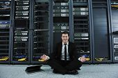 young handsome business man in black suit and tie practice yoga and relax at network server room whi