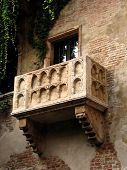 stock photo of juliet  - Exterior details of Romeo and Juliets balcony on side of historic house - JPG