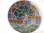 picture of stained glass  - stained glass inside of a church of a tree - JPG