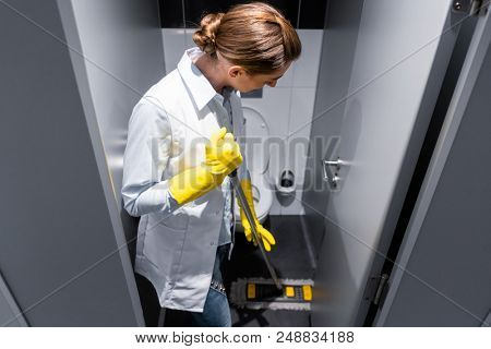 Cleaning lady or janitor mopping