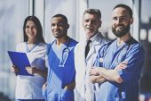 Team Of Professional Doctors With Medical Devices In Uniform Standing In Hospital. Nurse And Doctor  poster