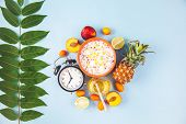 Morning Breakfast, Muesli, Fruit, Peaches , Ananas , Honey On A Blue Background With Green Leaves Aw poster