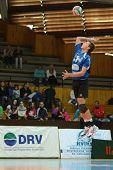 KAPOSVAR, HUNGARY - OCTOBER 29: Roland Gergye in action at a Hungarian National Championship volleyball game Kaposvar (blue) vs. Szolnok (red), October 29, 2011 in Kaposvar, Hungary.