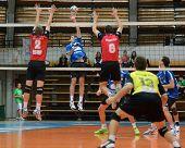 KAPOSVAR, HUNGARY - OCTOBER 29: Karoly Lesznyik (2nd from L) in action at a Hungarian National Championship volleyball game Kaposvar (blue) vs. Szolnok (red), October 29, 2011 in Kaposvar, Hungary.