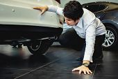 This Career Saleman Inspection Suspension Car Or Under The Car To Test The Quality For Customer Meta poster