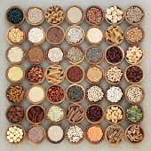 Vegan high protein dried health food with nuts, seeds, legumes, whole wheat pasta, grains & cereals. poster