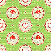 green polka dot pattern with red toadstool mushroom and heart seamless