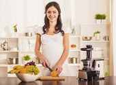 Pregnant Young Woman Cooking With Food Processor In Kitchen. Healthy Lifestyle. Vegetarian Food. Hea poster