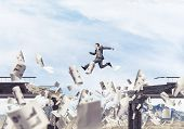 Businessman Jumping Over Gap In Bridge Among Flying Papers As Symbol Of Overcoming Challenges. Skysc poster