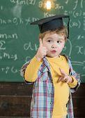 Idea Concept. Little Child Got Idea. Boy In Graduation Cap With Raised Finger Show New Idea. Bingo.  poster