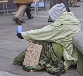 picture of homeless  - homeless man with sign in London City - JPG