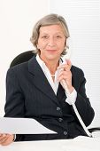 Senior Businesswoman On Phone Hold Empty Sheet