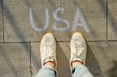 View From Above, Female Feet With Text Usa Written On Grey Sidewalk. poster