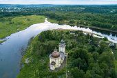 Top view of Orthodox Church Of The Resurrection and Vazhinka river. Kurpovo village in Vazhinsky urb poster