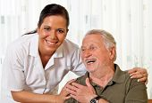stock photo of allowance  - a nurse in elderly care for the elderly in nursing homes - JPG