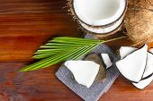 Coconut Topview Such As Coconut Half And Coconut Pieces And Leaf  On Wooden Table. poster