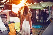 Beautiful Young Woman Walking On Festival Camping Tents For Sunset Dancig Party poster