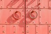 Metal Red Aged Textured Door With Rings Door Handles And Metal Rivets. Metal Architecture Background poster