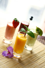 picture of fruit shake  - Colorful smoothies with fresh fruits strawberry kiwimango and bluebery - JPG