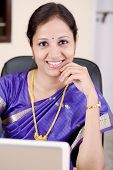 Traditional Young Woman At Office