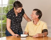 Senior Man Taking Blood Pressure With Wife