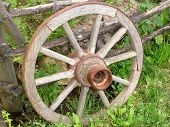 image of horse plowing  - Wooden Horse Carriage Wheel Leaned on a Fence - JPG