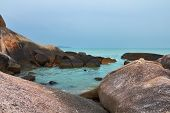Silent lagoon. A beach and picturesque rocks of island Samuj after flooding and a storm
