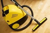 picture of cleaning service  - vacuum cleaner on a wooden parquet floor - JPG