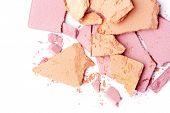 broken pink and orange eyeshadow isolated on white background