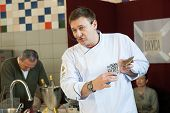 MOSCOW - APRIL 6: Chef Andrew Kuspits shows how to properly prepare and eat seafood at culinary master class