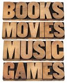 books, movies, music and games  - entertainment concept - collage of isolated words in vintage lette