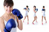 sport girl in boxing gloves with training fitness women in background, over white background