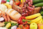image of ingredient  - Assorted grocery products including vegetables fruits wine bread dairy and meat - JPG