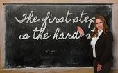 Teacher Showing The First Step Is The Hardest On Blackboard