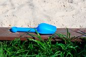 Child's Blue Scoop By Wood Sandpit