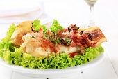 fried codfish fillet with lettuce
