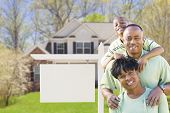 African American Family In Front of Blank Real Estate Sign and New House - Ready for Your Own Text.